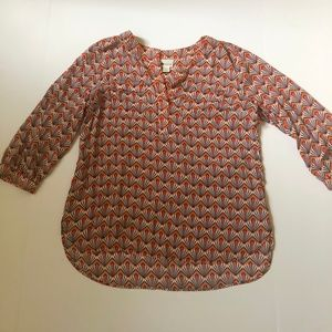 Pull over Orange blouse.